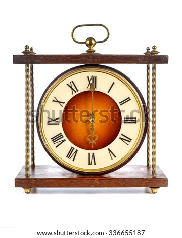 Old clock with roman numerals showing six o'clock over white background - stock photo