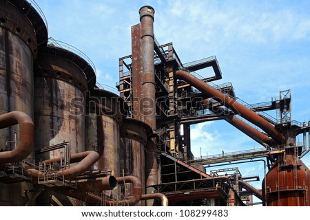 old close blast furnace under sky - stock photo