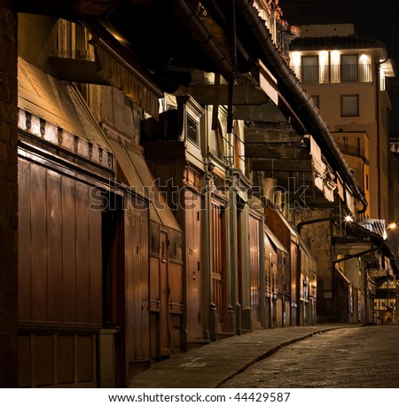 Old closed shops at night - stock photo