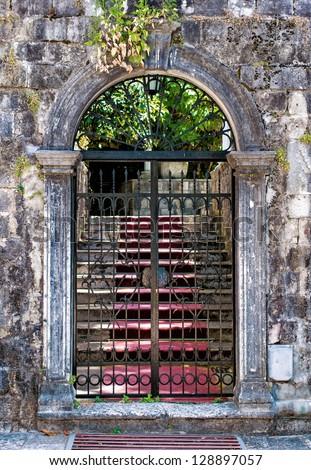Old closed wrought-iron gates - stock photo