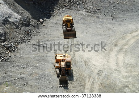 Old coal mine with machines gathering the resources - stock photo