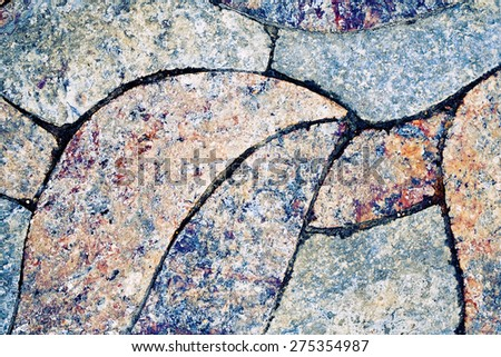 old cobblestone pavement on a square - stock photo