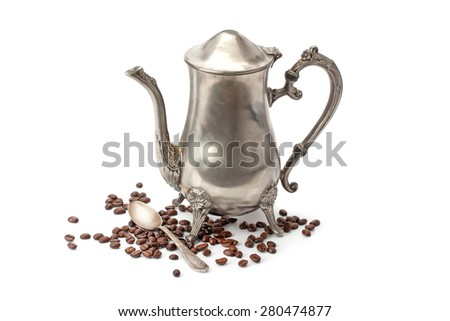 Old coffee pot, coffee beans and a silver spoon, isolated on white background - stock photo