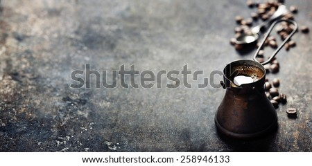 Old coffee pot on dark rustic  background - stock photo