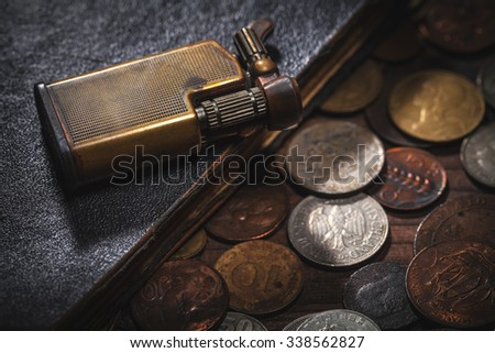 old coins and old lighter - stock photo