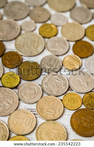 Old coins collection from European countries on wooden white background - stock photo