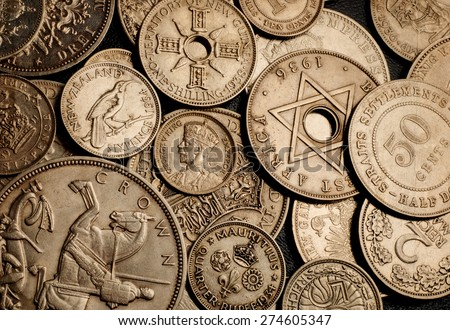 Old coins on grunge background - stock photo