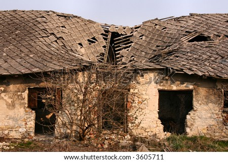 Old collapsed roof on a rural house. Polish countryside. - stock photo