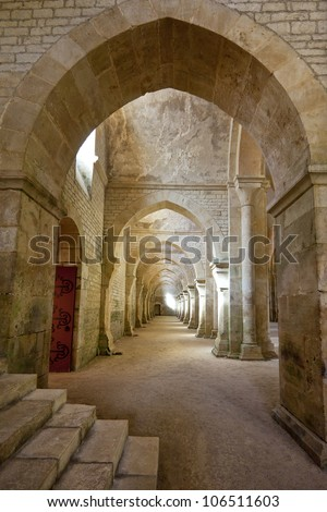 Old colonnaded interior shot in the Abbey of Fontenay in Burgundy - stock photo