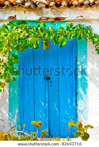 Old colored door in Greek house - stock photo