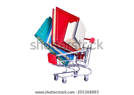 Old colorful books in the shopping cart isolated on white background - stock photo