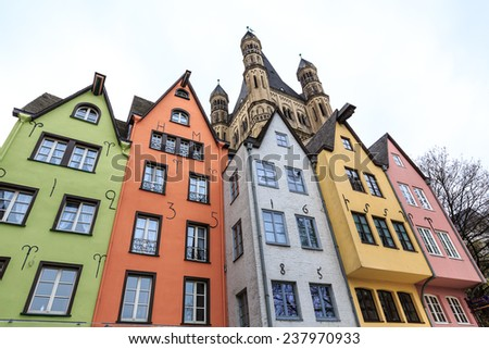 Old colorful houses with tower in the background in the city Cologne in Germany - stock photo