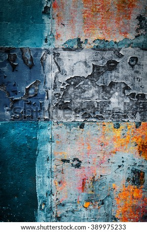 Old colorful rusty metallic surface with peeling paint and scratches - stock photo