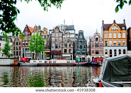 Old colourful buildings in Amsterdam - stock photo