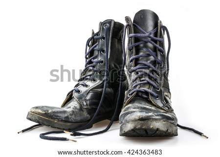 Old combat shoe isolated on white - stock photo