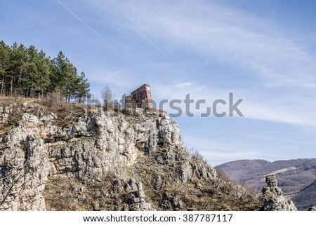 old communist symbol in the mountain - stock photo