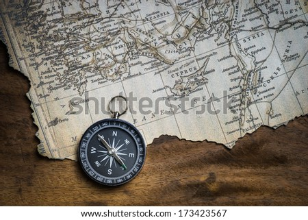 Old compass and ancient map - stock photo