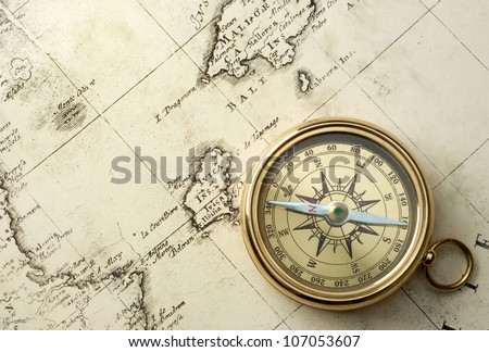 old compass and rope on vintage map 1732 - stock photo