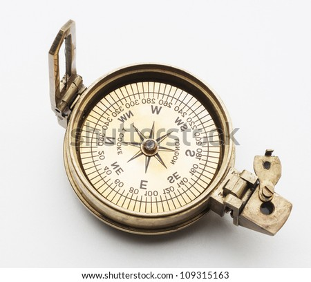 old compass isolated on white background - stock photo
