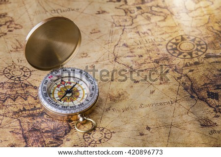 Old compass on map. - stock photo