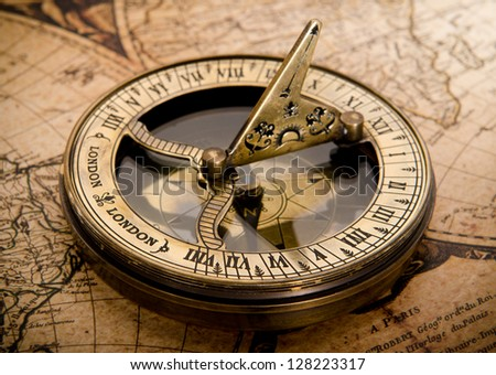 old compass on vintage map 1752 - stock photo