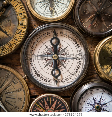 Old compass on vintage wood - stock photo