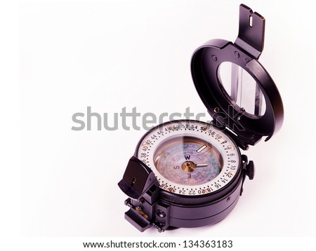 Old compass on white background - stock photo