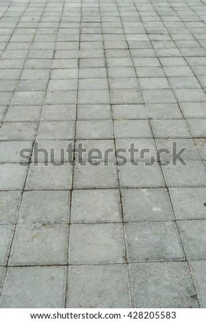Old concrete block floor perspective view - stock photo