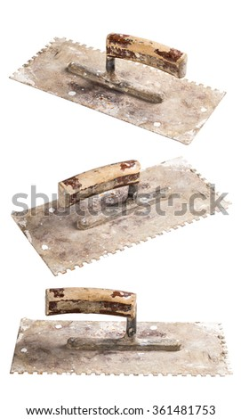 old construction trowel isolated on white background - stock photo