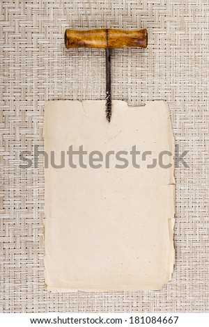 Old corkscrew on page parchment placing information. - stock photo