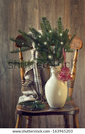 Old country house chair with cut sprigs of pine for Christmas - stock photo
