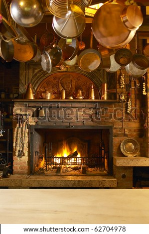 Old country style kitchen with fireplace - stock photo