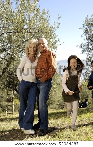 old couple and girl running - stock photo