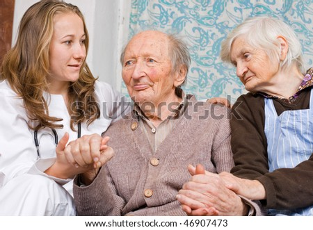 Old couple at the young doctor - stock photo