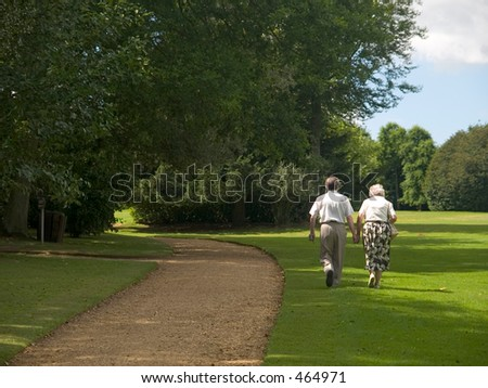 Old couple enjoying a countryside walk - stock photo