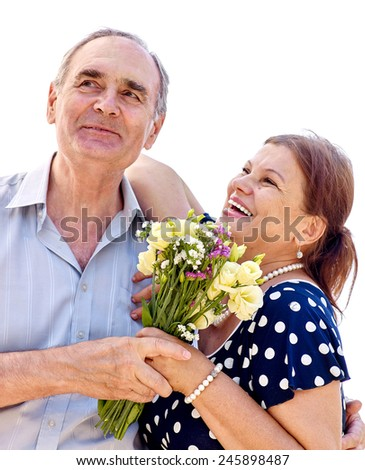 Old couple holding flower. - stock photo