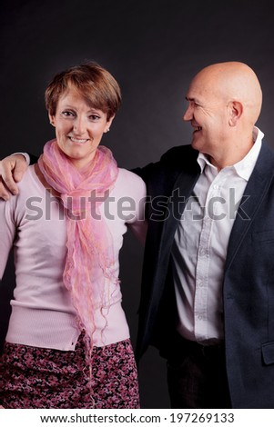 old couple loving each other; he looks at her - stock photo