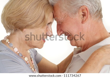 Old couple relaxing at home on a white background - stock photo
