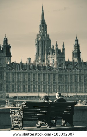 Old couple rest at Thames riverside with great view in London. - stock photo