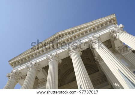 old court perspective against a blue sky - stock photo