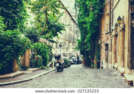 Old courtyard in Rome, Italy - stock photo