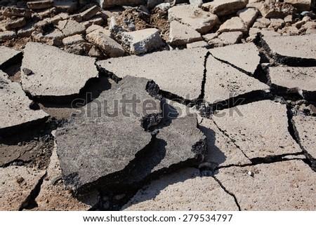 Old cracked asphalt closeup background - stock photo