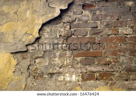 Old cracked brick wall - stock photo