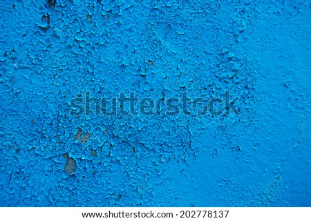 Old cracked paint pattern on concrete background. Peeling paint. Pattern of blue grunge material. Damaged paint. Scratched old plate - stock photo