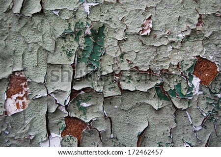 Old cracked paint pattern on rusty background. Peeling paint. Pattern of  grunge material. Damaged paint on the flake-board surface. Scratched old plate - stock photo