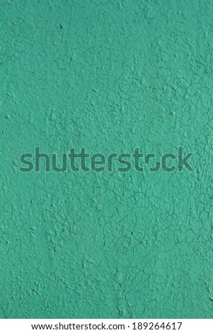Old cracked paint pattern on the blue wall background - stock photo