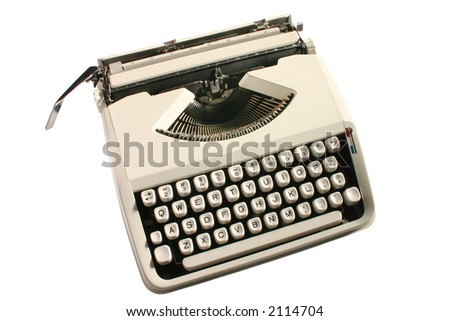 Old cream colored typewriter - stock photo