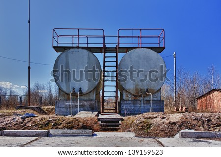 Old crude oil tank. - stock photo
