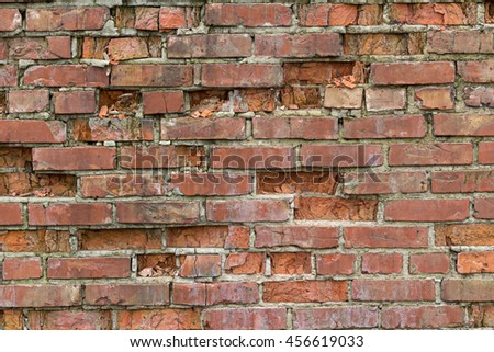 Old crumbling brick wall. Booms and textures - stock photo