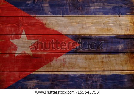 Old Cuba flag painted on wood aces - stock photo